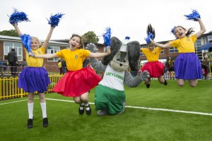 Pupils at St Mary's Catholic Primary School jump for joy after having LazyLawn installed in their playground - USG-5609