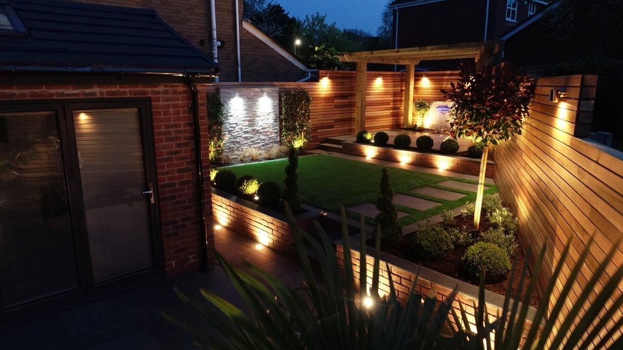 award-winning landscaping three-tiered garden at night wide view